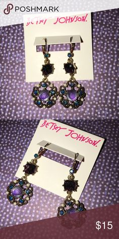"""Betsey Johnson Flower Medallion Drop Gold Earrings Betsey Johnson flower medallion drop earrings feature purple carved flower medallions with crystal accents and small faux pearl beads. The purple colored crystal gems and small crystal accents at the closure finish off the look.  Approximate drop:  2"""" Betsey Johnson Jewelry Earrings"""