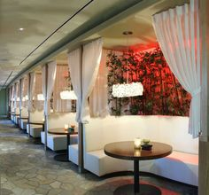 curtains add drama. lighting. Bar booths - banquette seating