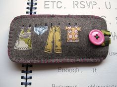 Love freehand machine embroidery ~ felt eyeglass case with clothesline theme {freehand machine embroidered lines on fabric appliques}