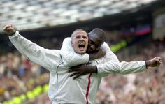Englands captain David Beckham, left, is congratulated by teammate Emile Heskey after scoring their second goal against Greece during their 2002 World Cup qualifying match at Old Trafford Manchester England main on Saturday, Oct. 6, 2001. (AP Photo/Adam Butler )