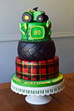 The Cake Flower | John Deere Tractor Cake - Plaid hand-painted after fondant was dry. Masking tape used for the large lines; the rest were done freehand. Corn was made on wires in advance, placed, and then buttercream was used as the accents. Tractor made with RKT.