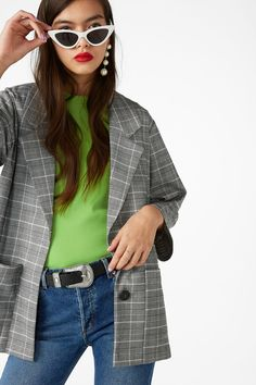 Craving an oversized, below-the-hip length, checked blazer? Check! Next step: Get out there and channel that inner boss.