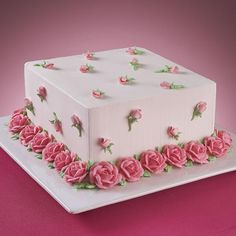 Abundant Roses Cake - A simple white cake can instantly become a vision of beauty with the addition of roses and rose buds. Make this magic happen on your cake for a special occasion.