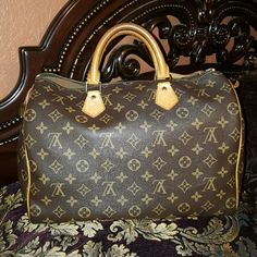 Louis  vuitton  speedy  35 Great shape. Not sure if it's authentic  I bought  it from a lady who said it is . I showed  a few people and some say it's real some say fake.?? listing it low because of that. Need to sell to pay some bills . Will post more pics Bags