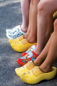 My Pop-pop had wood clogs from when he lived in Holland. Contiki Travelers Wearing Dutch Wood Clogs from Holland. Dutch Wooden Shoes, Wooden Clogs, Holland Netherlands, Amsterdam Netherlands, Rotterdam, Windmill, Rubber Rain Boots, How To Wear, Dutch Recipes