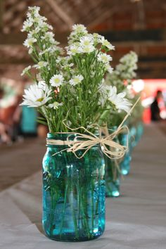 I wanted the original blue antique Mason jars for this table setting, but they were too expensive.  I used blue glass paint on clear Mason jars to get the look.
