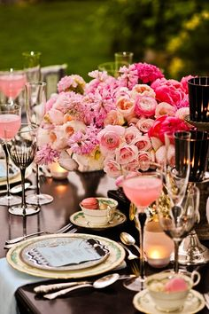 You know why this works?  While the peonies and whatnots are full and romantic, the glassware is thin and only a bit ornate.  And, there's no table cloth, the napkins act as the table linens under the plate.  Keeps the theme going without over powering the table.