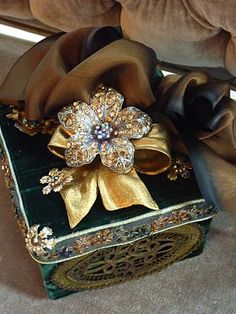 Romancing the Home....utilizing vintage brooch...I collect these...I will use some of my brooches next Christmas!!!