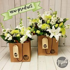 This bouquet is beautifully crafted of white and greenlocal in season…