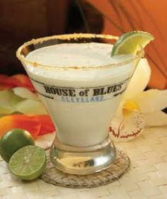 Key Lime Martini Recipe served at House of Blues in Downtown Disney at Disney World***2 ounces Absolut vanilla-infused vodka*** 1.5 ounces Monin key lime syrup*** 1 ounce sour mix*** 2.5 ounces half-and-half*** lime wedge for garnish*** Graham cracker crumb-rimmed martini glass