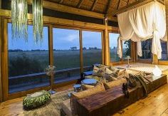 """On the northern part of the Okavango Delta lies Vumbura Plains Camp, Botswana. With only 14 canvas rooms each with its own plunge pool, indoor and outdoor shower. This game-rich location feature in our """"Premier Botswana"""" luxury safari. Image courtesy of Vumbura Plains Camp."""