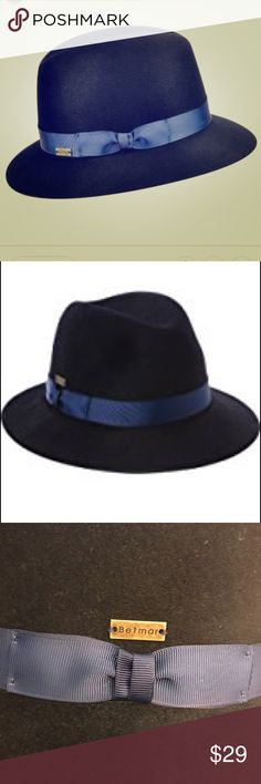 🆕 Betmar New York ❤️ Colleen Wool fedora S/M ❤️ Delight in this adorable Betmar Colleen Fedora in an adjustable size S/M. The hat is adjusted with the pictured ribbon :) The hat is a navy 100% wool. The ribbon forms a bow and is more of a navy then the picture shows. This item is brand new but does not have any tags :) 💖Thank you for visiting my closet 💖  🛍 Bundle and save 20%!! 🐙 This item comes from a pet- free home 🚭This item comes from a smoke- free home 🤔 Please feel free to…
