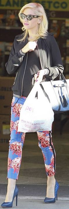 Who made  Gwen Stefani's pink floral pants, black cat sunglasses, and blue pumps?