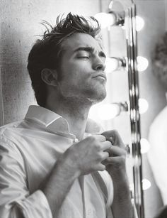 Robert Pattinson. Should be taking that off, not putting it on. ;) oh I love him!
