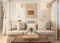 Home Decor, Home Remodeling-Living Rooms: Coastal Home with Neutral Interiors - What I love? The wall sconces flanking art, various textures in throw, pillows, accessories and furniture, draperies at wall opening.