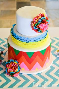 a fun fondant covered 3 tier cake for cinco de mayo, with bright colors, chevron pattern, ruffles and large colorful flowers! Pretty Cakes, Beautiful Cakes, Amazing Cakes, Cupcakes, Cupcake Cakes, Fiesta Cake, Fiesta Party, Crazy Cakes, Fancy Cakes