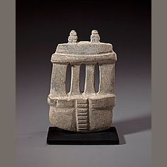 Mezcala Stone Temple,  Late Preclassic, ca. 300 - 100 B.C.  height 5 7/8in (14.5cm)   carved from medium gray stone with steps leading to four columns topped by lintels supporting two stylized standing human figures; smooth surface with heavy calcification.     Provenance:   The Lands Beyond Gallery, acquired in the 1960s   Private Collection, New York (numbered 622)