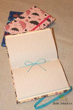 Caderno brochurinha A6.