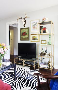 Whitney's Traditional Meets Glamour Austin Apartment IKEA Vittsjo Shelving and TV Unit spray painted gold