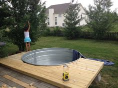 My stock tank pool with sun deck and filter system. Project turned out better than imagined and the kids loved it! Tank Pools, Round Stock Tank, Stock Tank Pool, Water Trough, Watering Trough Pool, Galvanized Stock Tank, Galvanized Buckets, Galvanized Steel, Water Tank