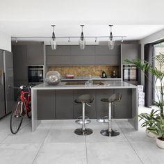 Sleek grey kitchen with handleless cabinets