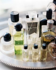 Tablescape Photo - Perfume bottles on a silver tray