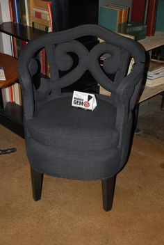 A beautiful chair at the Noir showroom is one of our #hiddengems at #hpmkt! TheHome.com