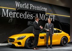 Nico Rosberg and Tobias Moers, head of AMG, on stage with Mercedes AMG GT