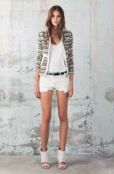 boucle jacket, open toe boots and shorts .