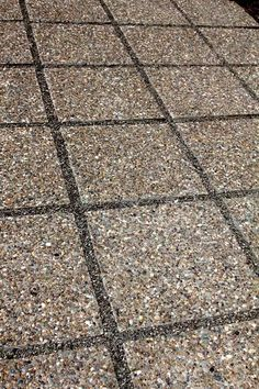 Exposed Aggregate Paver Patio With Decorative Gravel Spacing.