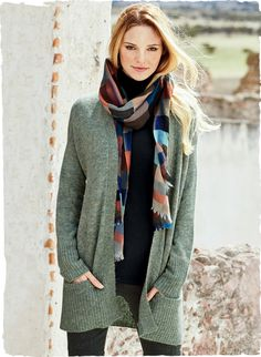 Autumn's coziest cardigan is sublimely soft and snuggly in woolen-spun baby alpaca (60%), nylon (35%) and merino wool (5%). The easy shape, with dolman sleeves, buttonless placket and exaggerated ribs.