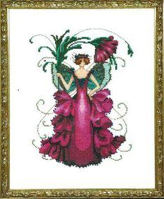 Nora Corbett Zinnia  (Pixie Blossom Fairy) - Cross Stitch Pattern. Model stitched on 32 Ct. Antique White Jobelan with DMC floss, Kreinik #4 Braid and Mill Hill