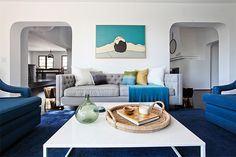 9 Smart Home Decor Tips To Revamp Your Space #refinery29  http://www.refinery29.com/spring-decor-ideas#slide9  Sometimes bright, white spaces can feel more cold than sunny, but this La Habra home is made comfortable and cool with shades of blue. Couches, blankets, carpet, pillows, and art all have cerulean in common, grounding the high-ceilinged space. Shop similar: West Elm Honeycomb Textured Wool Rug, from $849, available at West Elm; Anthropologie Willoughby Sofa, $1,598.00–1,998.00, ...