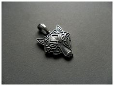 Hey, I found this really awesome Etsy listing at https://www.etsy.com/listing/191123040/silver-wolf-head-necklace-pendant-celtic