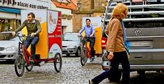 Raimund Rassillier (links) und Torsten Fauser, die Velocarrier-Geschäftsführer, steuern für das Foto  die  elektrisch unterstützten Lasten-Rikschas  durch die City. Foto: Horst Rudel