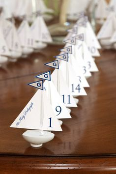Nautical inspiration for wedding reception table numbers.