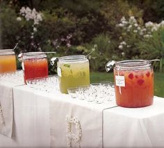 Will do this idea, but will use pretty beverage dispensers and maybe even garnish glasses + put out nice straws  to match drink/glass. (Mason jars filled with summer drinks. A great idea for outdoor wedding receptions or events.)