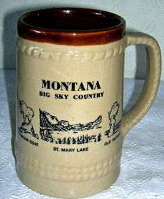 Montana Stoneware Tall Mug Old Faithful Mt St Mary and a Mountain Goat Christmas Figurines, Christmas Mugs, Tall Coffee Mugs, Old Faithful, Mugs For Men, Wooden Tree, Stoneware Mugs, Glazes For Pottery, Cool Items
