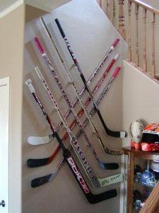 Hockey Bedroom : Creative hockey stick wall display and storage using Cross Mount Spacers Hockey Mom, Field Hockey, Ice Hockey, Hockey Stuff, Hockey Man Cave, Hockey Girls, Hockey Crafts, Hockey Decor, Hockey Bedroom