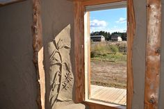 A view from a lower window of the Old Main building, constructed from straw bales and cob, toward two energy-efficient rental units on the H...