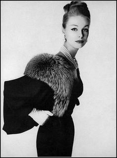 Monique Chevalier in sheer black wool suit, the jacket trimmed in Canadian silver fox by Hannah Troy, photo by Irving Penn, Vogue, 1958   by skorver1