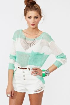 Lightweight mint and white stripe knit featuring a loose weave and rolled chest pocket. Rolled cuff and hem. Loose fit. Looks awesome tossed over a bikini and denim shorts!