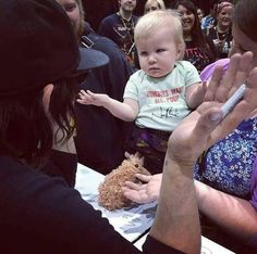 Norman Reedus playing with a baby at Wizard World Reno Comic Con 2014 #thewalkingdead #twd #thewalkingdeadseason7 #twdfamily #twdfinale #amc #walkingdead #rickgrimes #andrewlincoln #norman #normanreedus #daryl #dixon #michonne #chandler #chandlerriggs #carl #carlgrimes #carol #negan #lucille #maggie #glenn #love