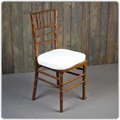 Fruitwood Chiavari Chair -- Shown with a tie-on chair pad available in black, white and ivory - order separately. Micro suede or Topaz seat pad covers also available separately.