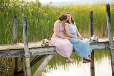 Brides on the dock of Alyson's Orchard- An LGBTQ friendly wedding venue. Photo by Steve Holmes Photography