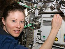 #Astronaut #Tracy #Caldwell #Dyson working at a #Microgravity #Experiment #Research Locker Incubator, or #MERLIN, aboard the #International #Space #Station. (NASA)