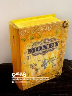 """Money, money, money. Must be funny. In the rich man's world. The customer wanted us to customized a box to keep money. This idea is transform the plain wooden box to an vintage golden money book with 3D ornaments on top and bottom. The book cover (box) with a title """" Show me the money"""" with diamonds, notes, coins, wallets & etc icons surrounding. the bottom is the world map with global currency symbols. We wish the customer luck in getting more money!"""