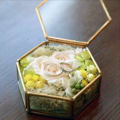 A simple yet elegant hexagonal glass box for a ring bearer looks quite suitable for your engagement day. Also, add some florals to prettify it even more. Ring Pillow Wedding, Wedding Pillows, Wedding Ring Box, Diy Wedding, Wedding Couples, Engagement Ring Platter, Best Engagement Rings, Wedding Themes, Wedding Decorations