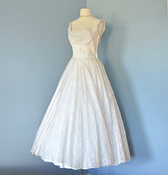 Vintage 1950s Wedding Dress...Beautiful Ceil Chapman Ballerina Length Ivory Organza Wedding Dress. $465.00, via Etsy.