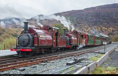 """0-4-0 saddle tank """"Small England"""" steamlocomotives # 4 """"Palmerston"""" and # 2 """"Prince"""" of the Ffestiniog Railway with a train from Porthmadog to Rhyd Ddu in Beddgelert. This was a photo charter train. In the rear is 2-6-2 T locomotive """"Lyd""""."""